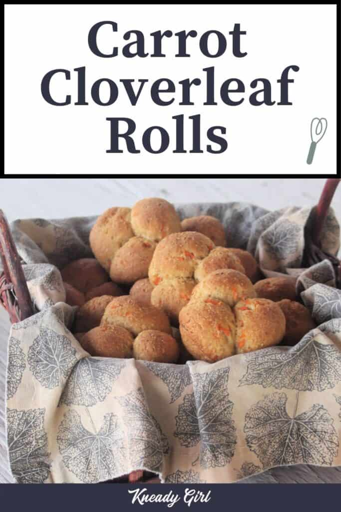 A napkin lined basket full of carrot cloverleaf rolls with text overlay.