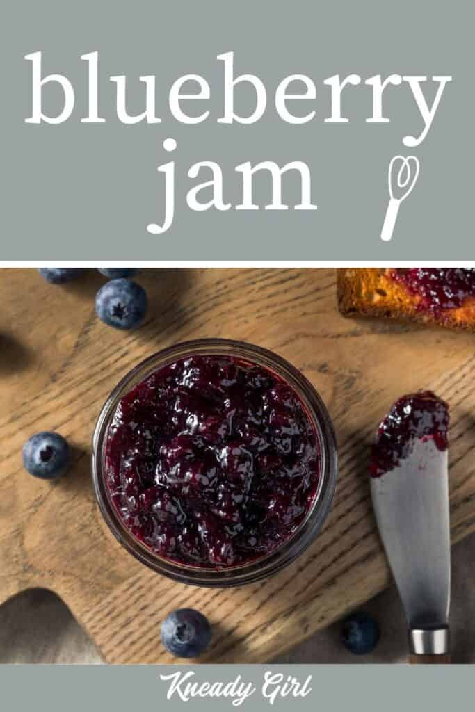 An open jar of blueberry jam seen from above with a spreader and piece of toast with a text overlay.