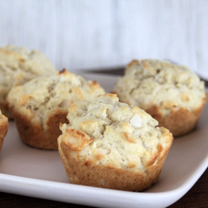 Coconut muffins on a white plate.
