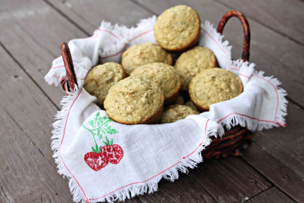A napkin lined basket full of hemp heart and oatmeal muffins