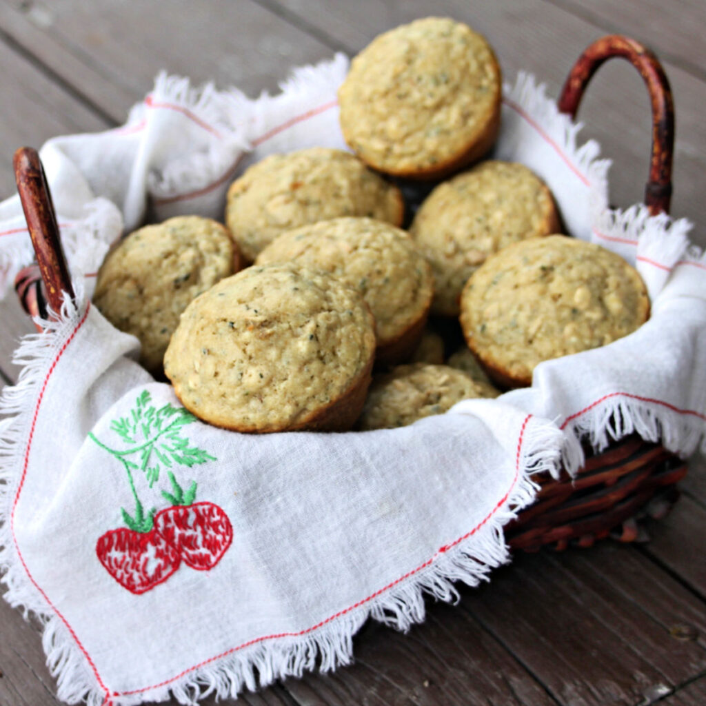 Hemp heart muffins stacked in a napkin lined basket.