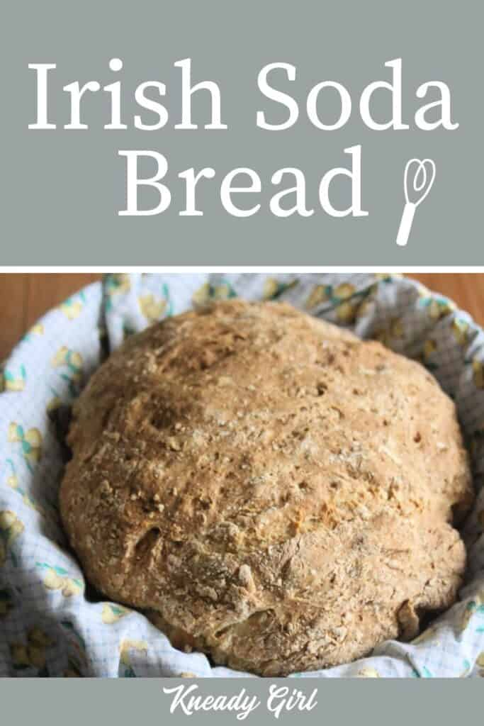 A loaf of Irish Soda Bread in a linen lined basket with text overlay.