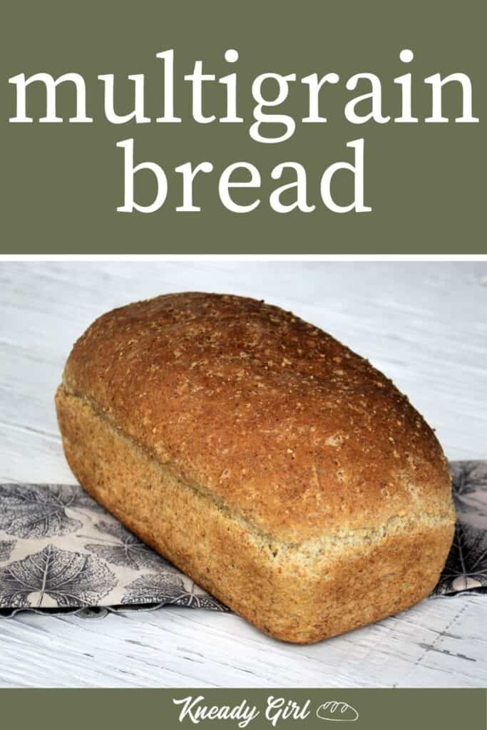 A loaf of multigrain bread on a napkin with text overlay.
