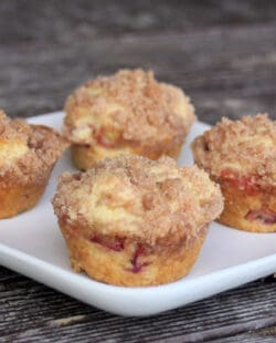 Rhubarb muffins on a square white plate.