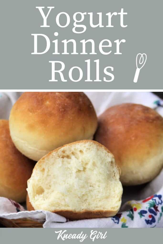 A dinner roll torn in half exposing the inside sitting inside a full basket of rolls with text overlay.