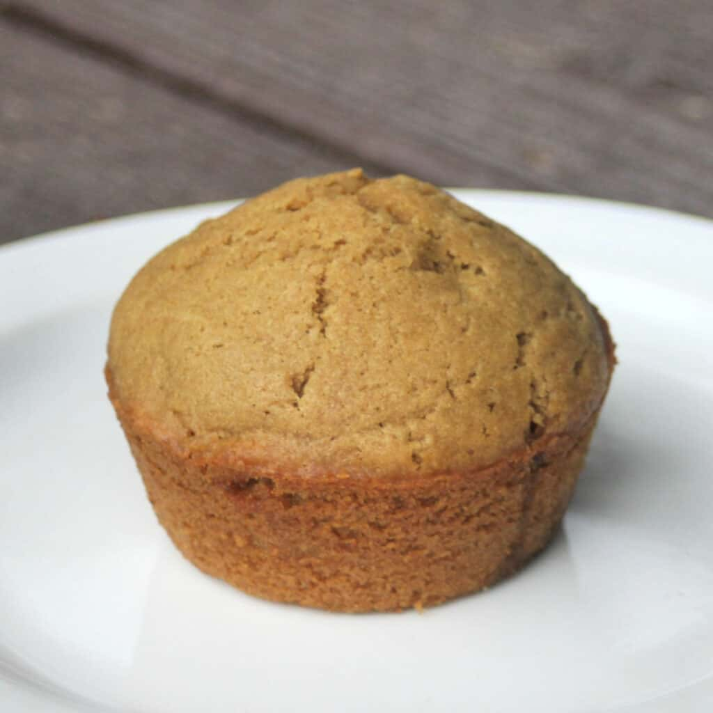 A coffee muffin on a white plate.