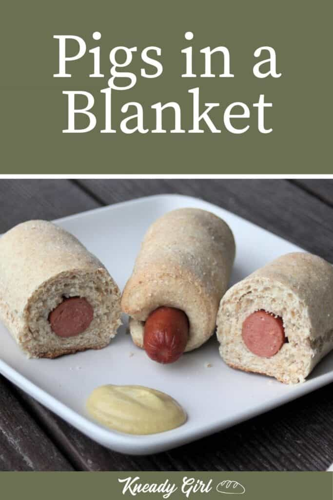 Pigs in a blanket on a white plate with mustard and text overlay.