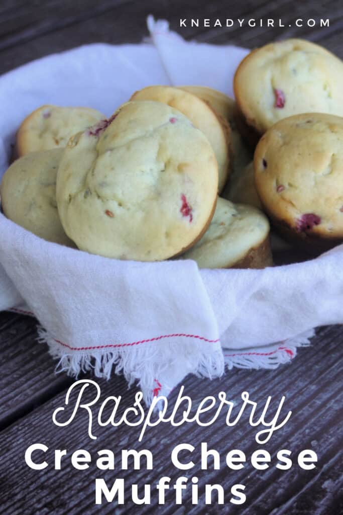 A white linen basket full of raspberry cream cheese muffins with text overlay.