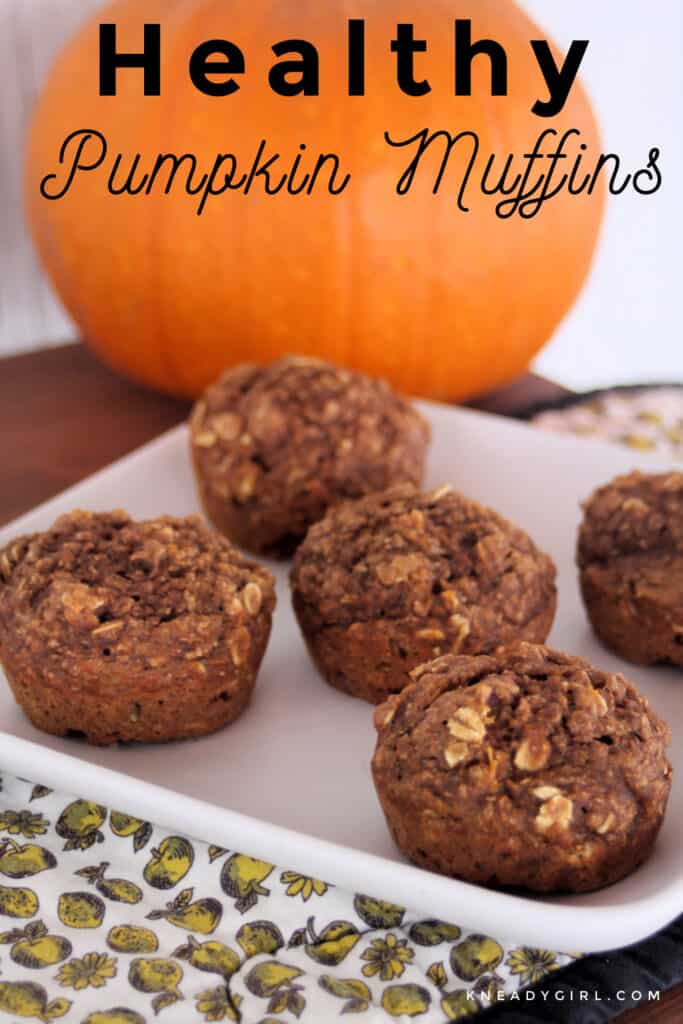 Healthy pumpkin muffins on a square white plate with a pumpkin in the background and text overlay.