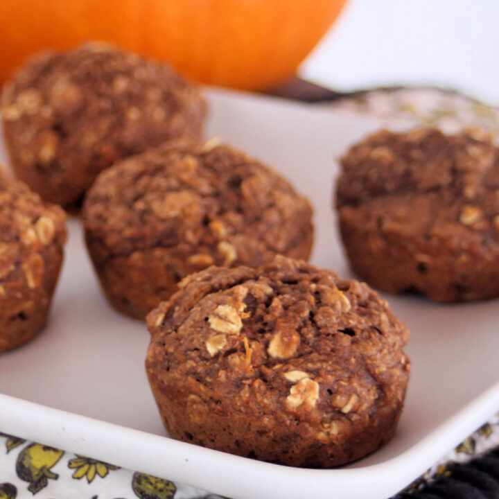 Healthy pumpkin muffins on a square white plate.