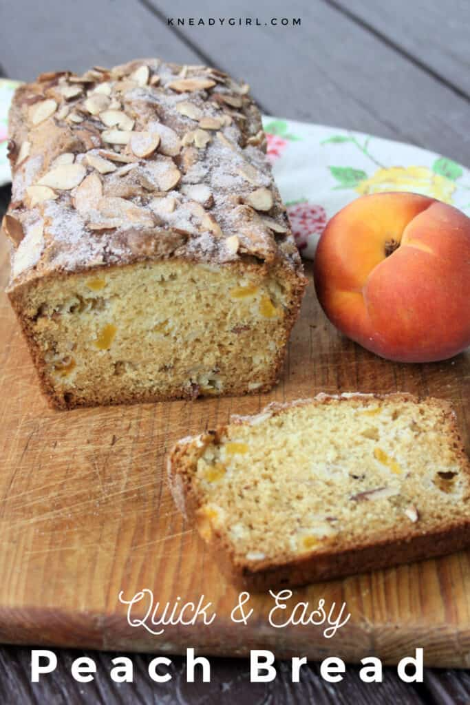 A loaf of peach bread on a wooden cutting board sitting behind a slice of bread with a fresh peach to the right side with text overlay.