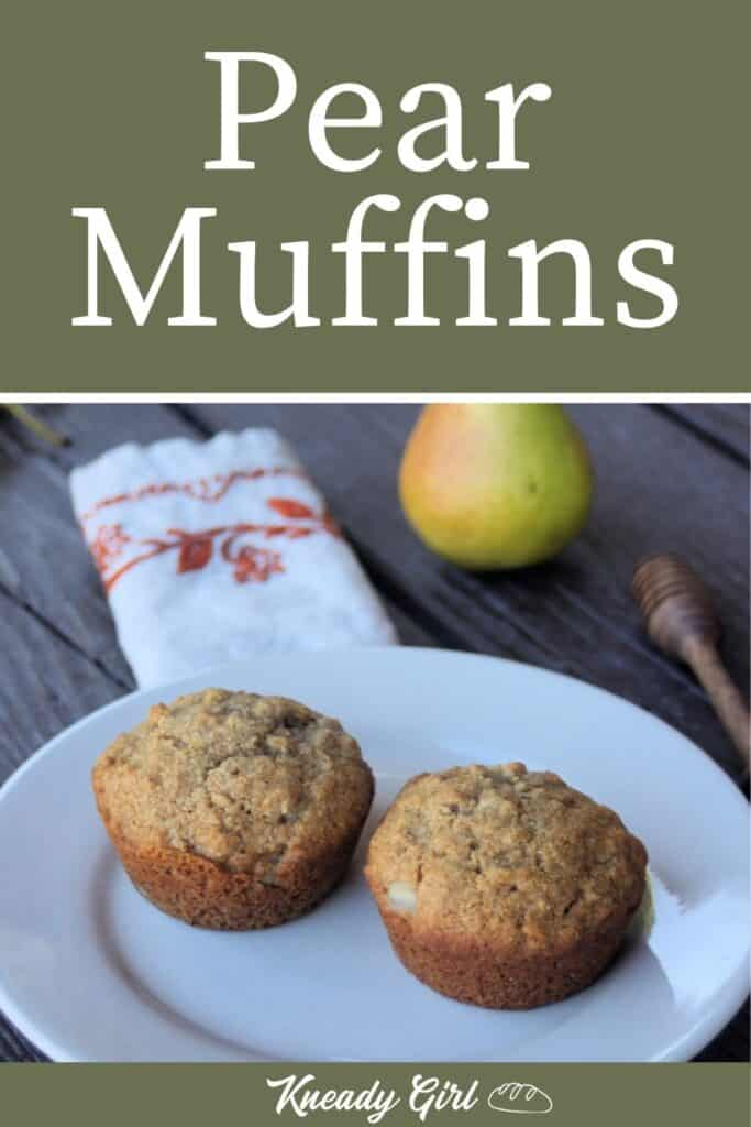 2 muffins on a white plate with a napkin, fresh pear, and honey dipper in the background. Includes text overlay stating: pear muffins.