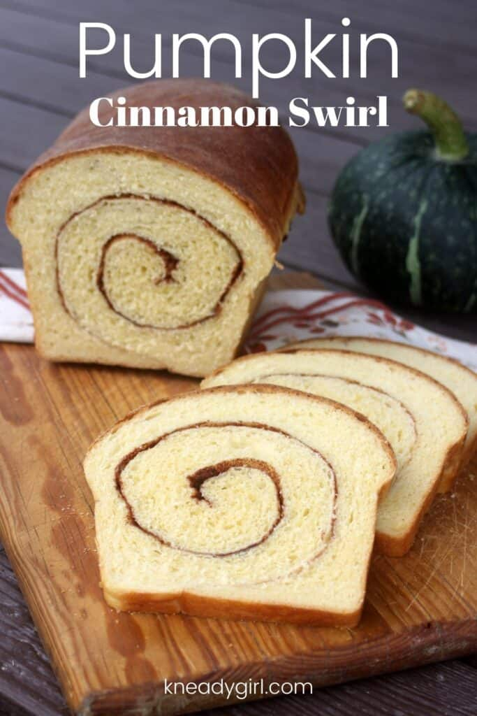 Slices of bread on a board sitting in front of the remaining loaf with a green pumpkin in the background and text overlay reading: pumpkin cinnamon swirl.