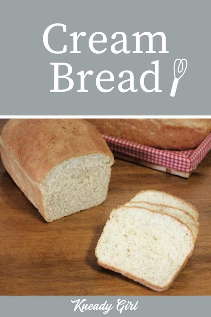 Slices of cream bread on a table sitting in front of the rest of the loaf with another loaf in a basket in the background with text overlay stating: Cream Bread.