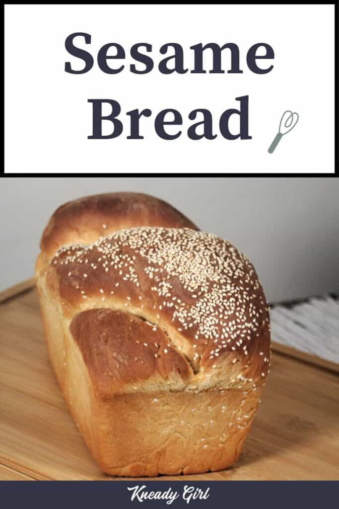 A loaf of bread topped with sesame seeds sitting on a cutting board with text overlay stating: Sesame Bread.