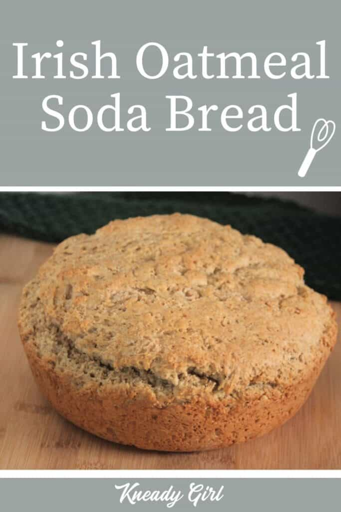 A round loaf of bread on a table with text overlay reading: Irish Oatmeal Soda Bread.