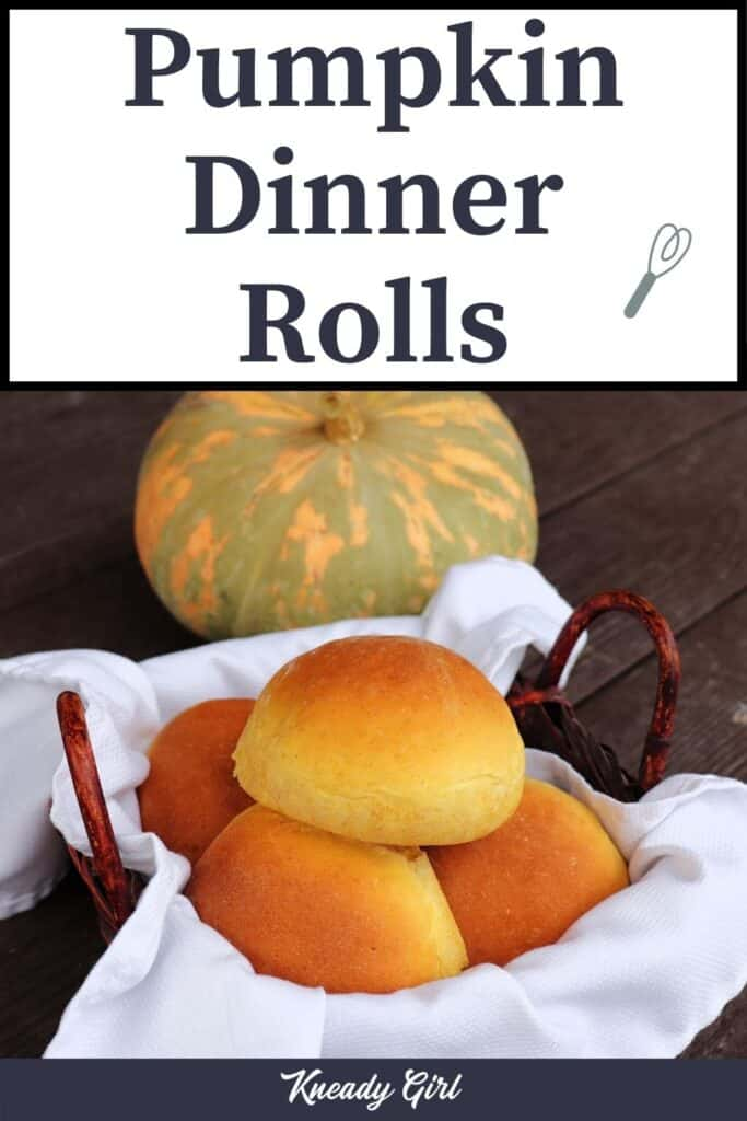 A white napkin lined basket full of pumpkin dinner rolls sitting in front of a green and orange striped pumpkin with text overlay stating: Pumpkin Dinner Rolls..