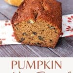 A loaf of bread with the end cut off exposing the inside with a pumpkin in the background with text overlay stating pumpkin nut bread.