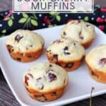 Muffins on a plate as seen from above with text overlay reading: sour cherry muffins with dark chocolate chunks.